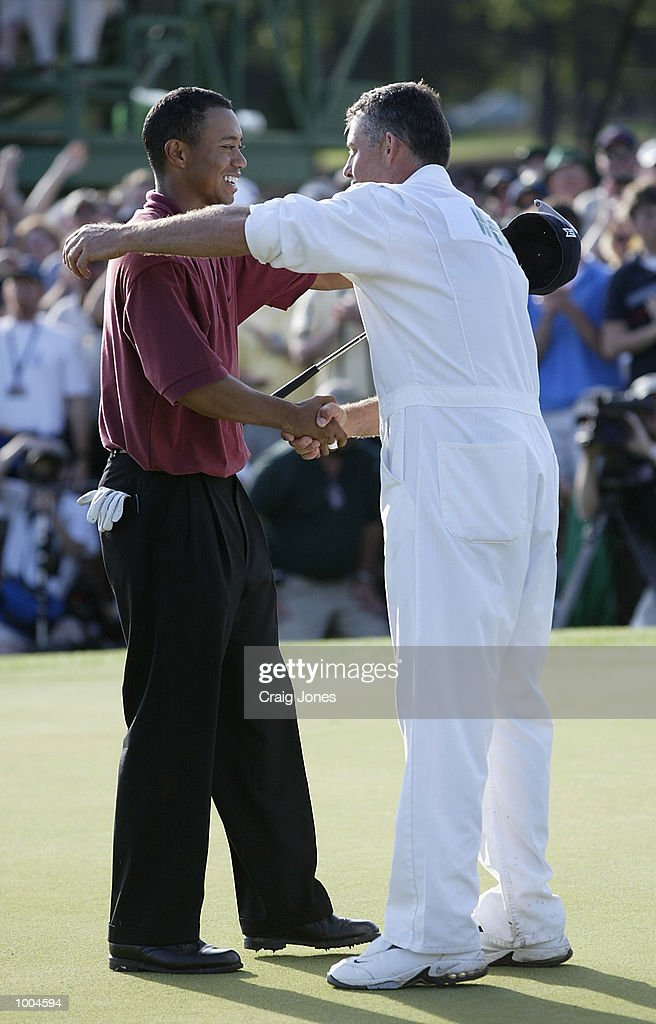 Tiger Woods of the USA celebrates with his caddie Steve Williams after his victory on the 18th green during the final round of the Masters Tournament from the Augusta National Golf Club in Augusta, Georgia. DIGITAL IMAGE. EDITORIAL USE ONLYMandatory Credit: Craig Jones/Getty Images