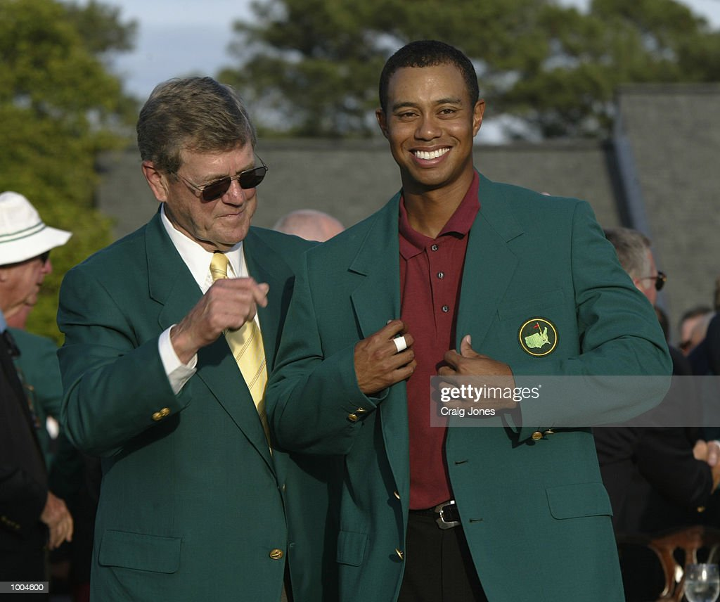 Tiger Woods of the USA is presented with his green jacket by Hootie Johnson after winning the Masters Tournament from the Augusta National Golf Club in Augusta, Georgia. DIGITAL IMAGE. EDITORIAL USE ONLY Mandatory Credit: Craig Jones/GettyImages
