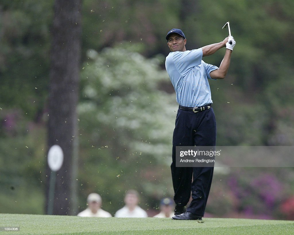 Tiger Woods of the USA plays his second shot on the 14th hole during the third day of the Masters Tournament from the Augusta National Golf Club in Augusta, Georgia. DIGITAL IMAGE. EDITORIAL USE ONLY Mandatory Credit: Andrew Redington/GettyImages