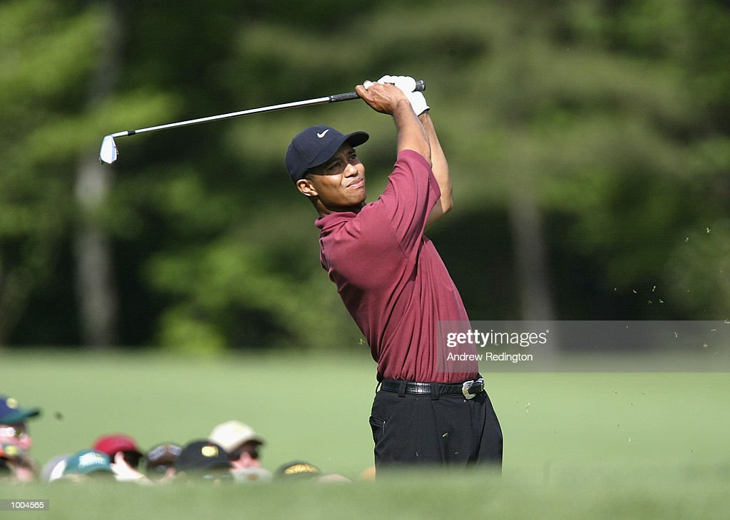 Tiger Woods of the USA plays his tee shot on the 11th hole during the final round of the Masters Tournament from the Augusta National Golf Club in Augusta, Georgia. DIGITAL IMAGE. EDITORIAL USE ONLY Mandatory Credit: Andrew Redington/GettyImages