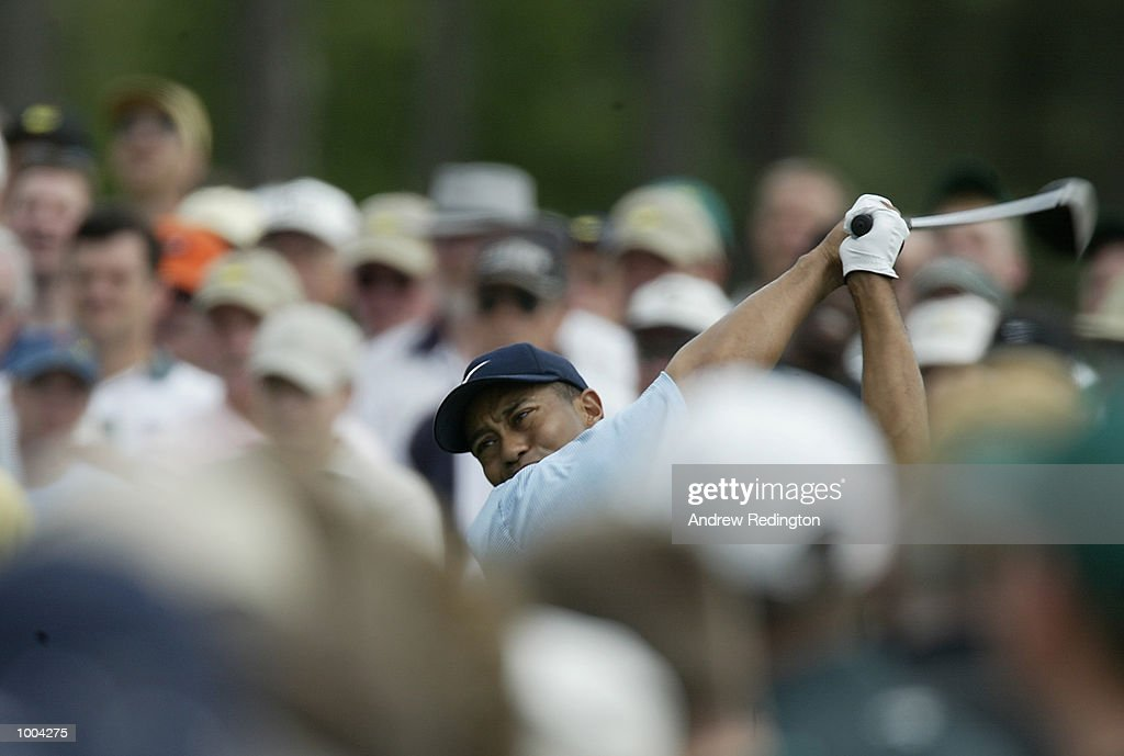 Tiger Woods of the USA plays his tee shot on the eighth hole during the third day of the Masters Tournament from the Augusta National Golf Club in Augusta, Georgia. DIGITAL IMAGE. EDITORIAL USE ONLY Mandatory Credit: Andrew Redington/GettyImages