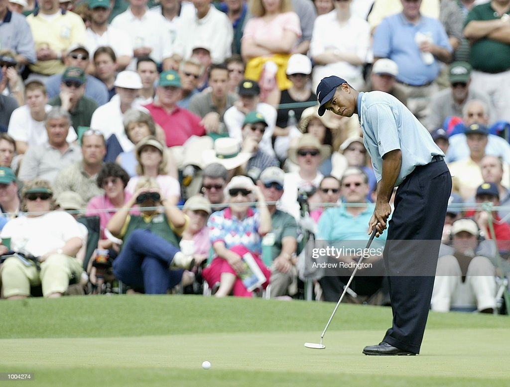 Tiger Woods of the USA putts for birdie on the sixth green during the third day of the Masters Tournament from the Augusta National Golf Club in Augusta, Georgia. DIGITAL IMAGE. EDITORIAL USE ONLY Mandatory Credit: Andrew Redington/Getty Images