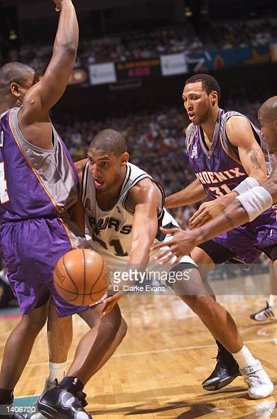 Tim Duncan of the San Antonio Spurs finds a space for the past around Alton Ford of the Phoenix Suns during the 2nd quarter of the game at the...