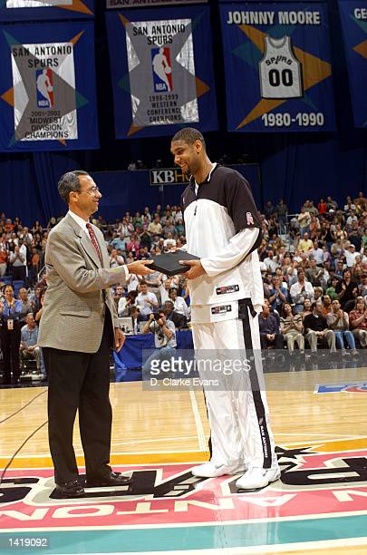Tim Duncan of the San Antonio Spurs receives the 20012002 IBM Award before game 2 of the Western Conference QuarterFinals series against the Seattle...