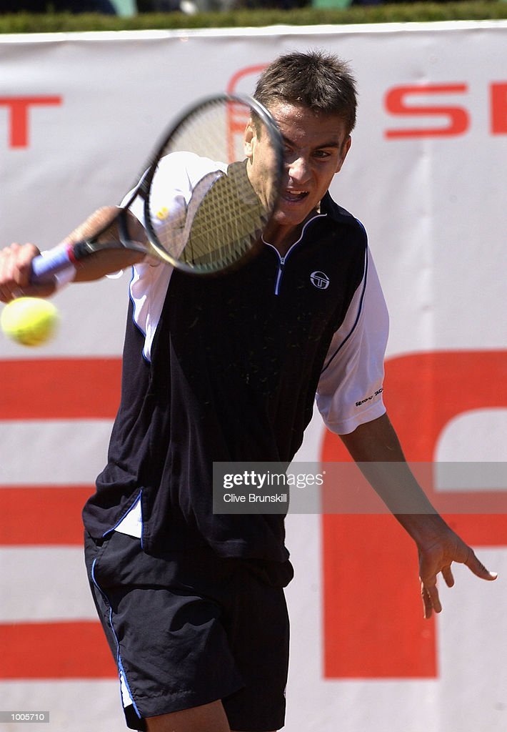 Tommy Robredo of Spain plays a backhand during his first round match against Marc Lopez of Spain during the Open Seat Godo, Barcelona, Spain . DIGITAL IMAGE Mandatory Credit: Clive Brunskill/Getty Images