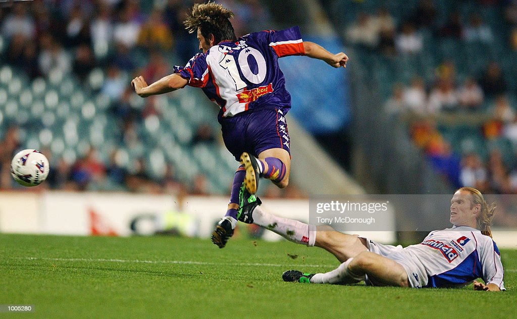 Travis Dodd #7 for Newcastle fails to block Bobby Despotovski #10 for the Glory during the major semi-final first leg between Perth Glory v Newcastle United, played at the Subiaco Oval. DIGITAL IMAGE Mandatory Credit: Tony McDonough/Getty Images