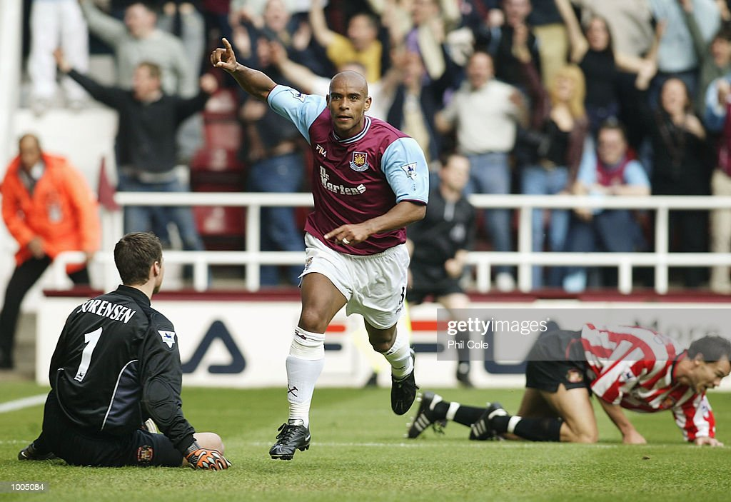Trevor Sinclair of West Ham celebrates after scoring the opening goal as Sunderland keeper Thomas Sorensen sits on the pitch during the FA Barclaycard Premiership match between West Ham United and Sunderland at Upton Park, London. DIGITAL IMAGE. Mandatory Credit: Phil Cole/Getty Images