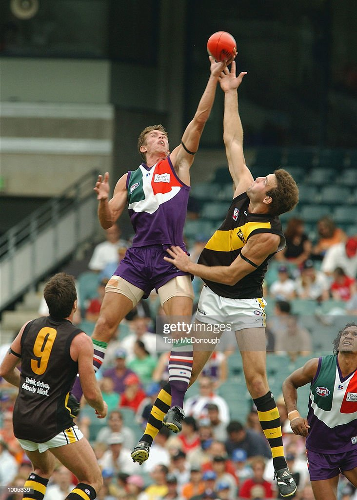 Troy Simmonds #2 for the Dockers and Brad Ottens #5 for the Tigers during the AFL match between the Fremantle Dockers and the Richmond Tigers, played at the Subiaco Oval, Western Australia. DIGITAL IMAGE. Mandatory Credit: Tony McDonough/Getty Images