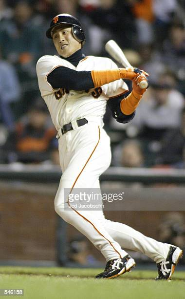 Tsuyoshi Shinjo of the San Francisco Giants singles against the Los Angeles Dodgers at Pac Bell Park in San Francisco California DIGITAL IMAGE...