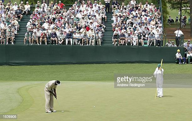 Vijay Singh of Fiji putts for an eagle on the 15th hole during the second day of the Masters Tournament from the Augusta National Golf Club, Augusta,...