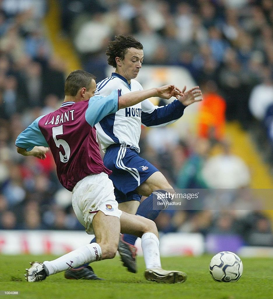 Vladimir Labant of West Ham tries to tackle Simon Davies of Tottenham Hotspur during the FA Barclaycard Premiership match between Tottenham Hotspur and West Ham United at White Hart Lane, London. DIGITAL IMAGE Mandatory Credit: Ben Radford/Getty Images