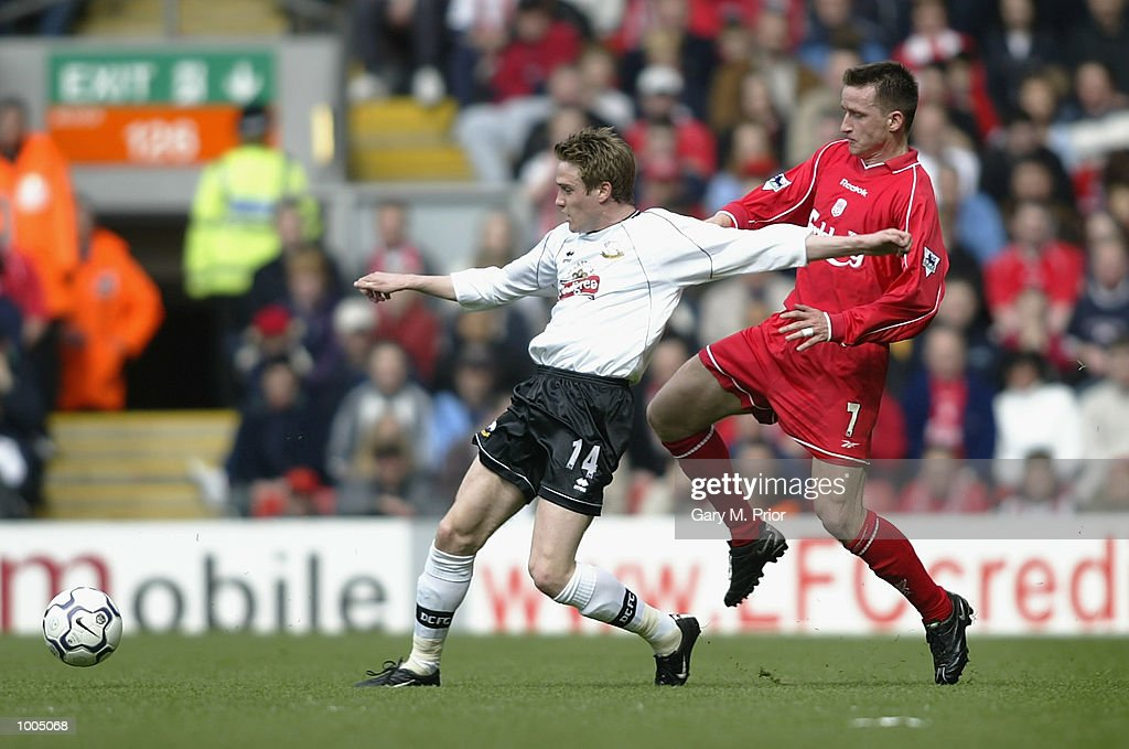 Vladimir Smicer of Liverpool clashes with Lee Morris of Derby during the Liverpool v Derby County FA Barclaycard Premeirship match at Anfield, Liverpool. DIGITAL IMAGE. Mandatory Credit: Gary M. Prior/Getty Images