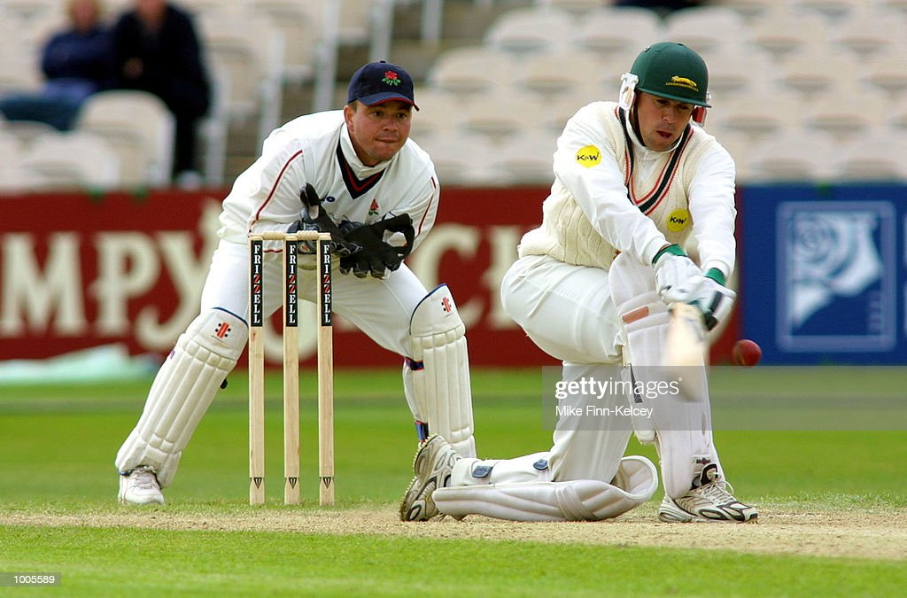 Warren Hegg of Lancashire looks on as Neil Burns of Leiestershire hits out on his way to 62 in the Frizzell County Championship match at Old Trafford, Manchester. DIGITAL IMAGE Mandatory Credit: Mike Finn Kelcey/Getty Images