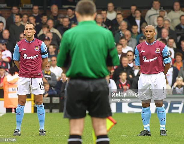 West Ham Captain Paolo Di Canio and Trevor Sinclair respect the minutes silence followed by the Engligh National Anthem before the FA Barclaycard...