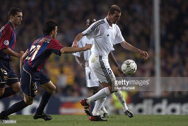 Zinedine Zidane of Real Madrid is pursued by Luis Enrique of Barcelona during the UEFA Champions League Semi Final First Leg match between Barcelona...
