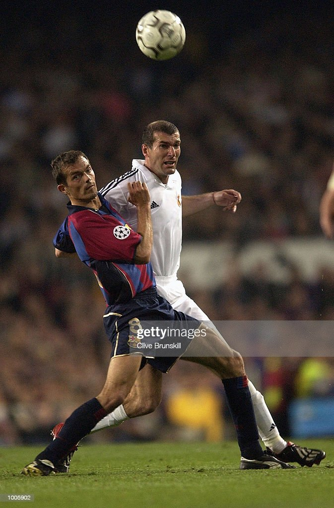 Zinedine Zidane of Real Madrid tangles with Phillip Cocu of Barcelona during the UEFA Champions League Semi Final First Leg match between Barcelona and Real Madrid at the Nou Camp, Barcelona, Spain. DIGITAL IMAGE Mandatory Credit: Clive Brunskill/Getty Images