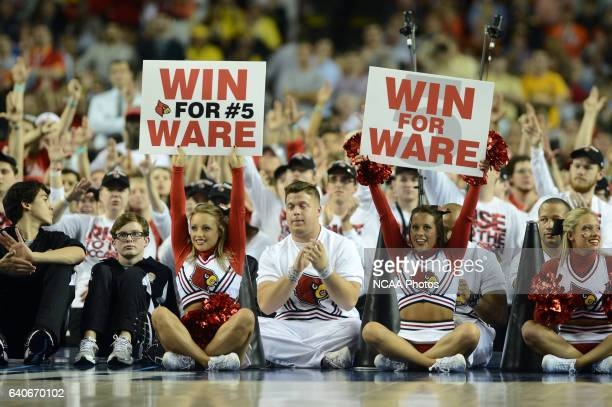 University of Louisville cheerleaders hold up signs for injured player Kevin Ware against Wichita State University in the semifinal game of the 2013...