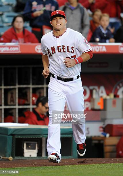 Los Angeles Angels of Anaheim Mike Trout runs onto the field to receive his silver slugger award before a game against the Seattle Mariners played at...
