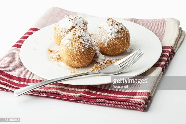 Apricot dumpling in plate on white background