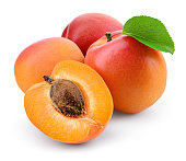 Apricot isolate. Apricots with slice on white. Fresh apricots. With clipping path. Full depth of field.