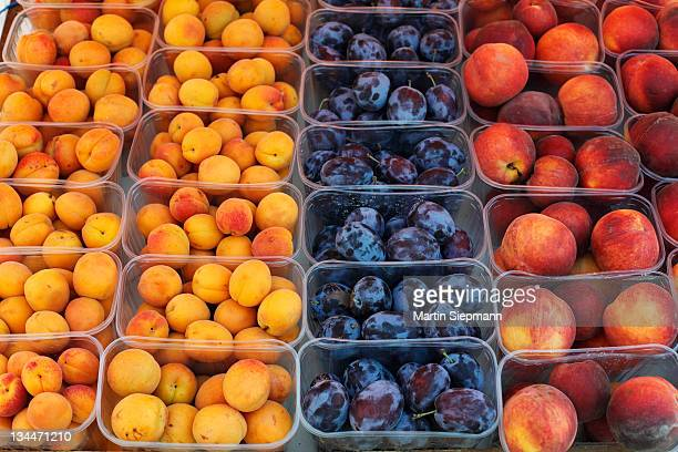 Apricot, plums and peaches in plastic cups, Wachau, Lower Austria, Austria, Europe