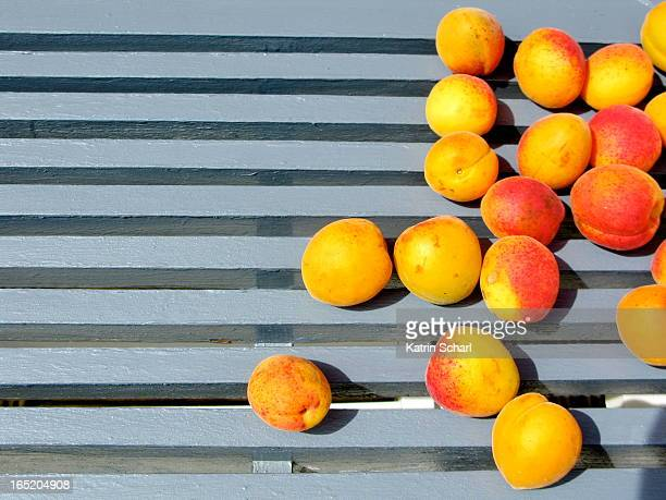 Apricots on a blue garden table