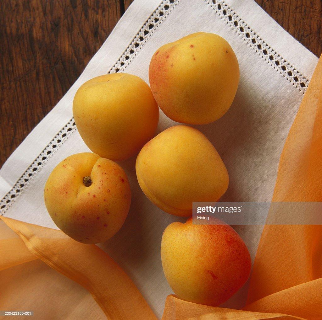 Apricots On White Cloth : Stock Photo
