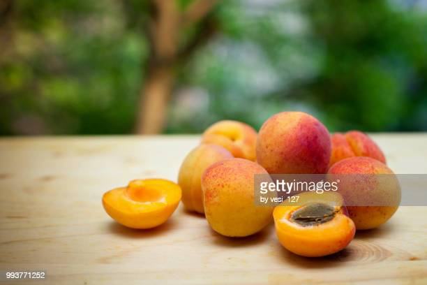 apricots on wooden board - apricot stock pictures, royalty-free photos & images