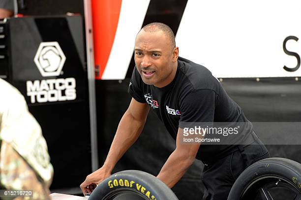 Antron Brown Don Schumacher Racing NHRA Top Fuel Dragster checks fuel before the third round of qualifying for the 17th Annual Denso Spark Plugs NHRA...