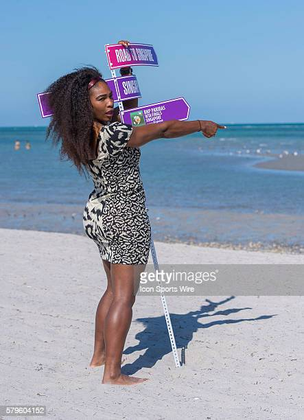 Serena Williams poses with her Championship trophy on Crandon Beach after defeating Carla Suarez Navarro 62 60 at the 2015 Miami Open at the Crandon...