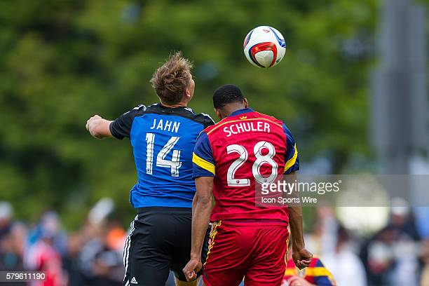 San Jose Earthquakes forward Adam Jahn and Real Salt Lake defender Chris Schuler battle for aerial possession during a major league soccer game...