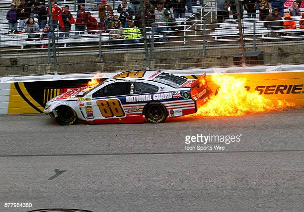 Sprint Cup Series driver Dale Earnhardt Jr hits the wall and his car and catches on fire during the NASCAR Sprint Cup Series Duck Commander 500 at...