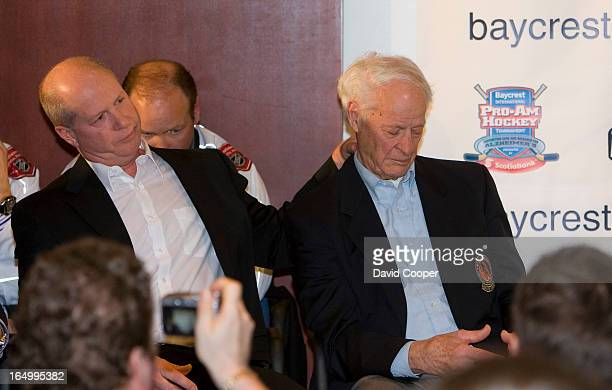 April 1 2009- Marty Howe tries to comfort his dad Gordie as they announce a fund to honour his wife Colleen who died last month of Pick's disease....