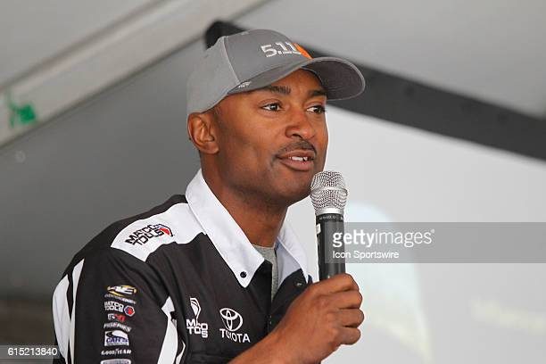 Antron Brown Don Schumacher Racing speaks to students of the NHRA YES program presented by the US Army during the DENSO Spark Plugs NHRA Nationals at...