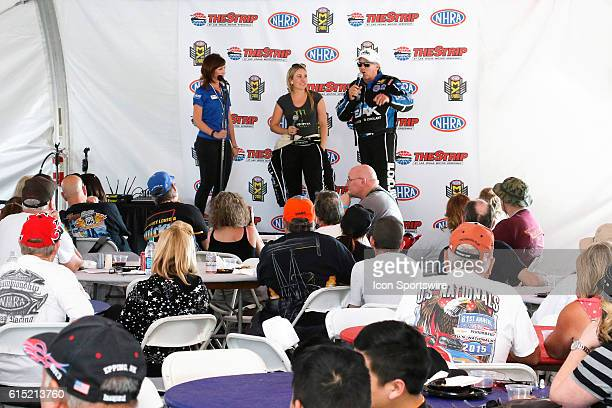 John Force and Brittany Force speak during a driver appearance in the Club Nitro hospitality tent during the DENSO Spark Plugs NHRA Nationals at The...