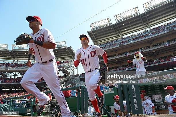 Washington Nationals shortstop Ian Desmond and Washington Nationals third baseman Ryan Zimmerman take the field to start the game against the Miami...