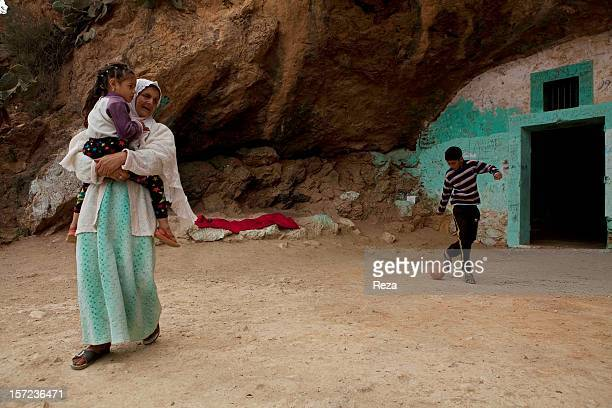 April 10th Algeria A young girl is playing near the koubba erected over the tomb of the Sufi master Sidi Abdelkader Al Jilani People like to come to...