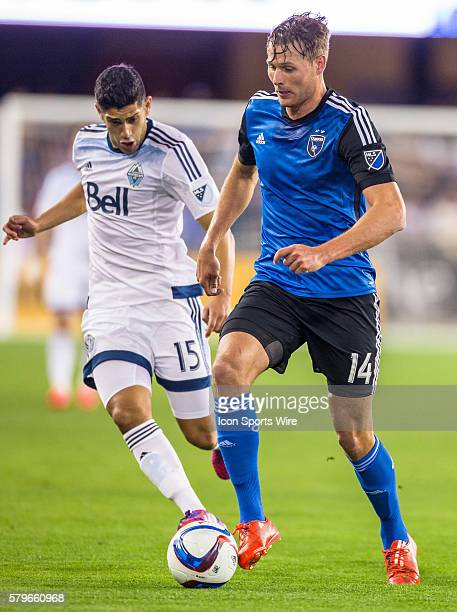 San Jose Earthquakes forward Adam Jahn and Vancouver FC midfielder Matias Laba battle for possession during an MLS soccer game between the San Jose...