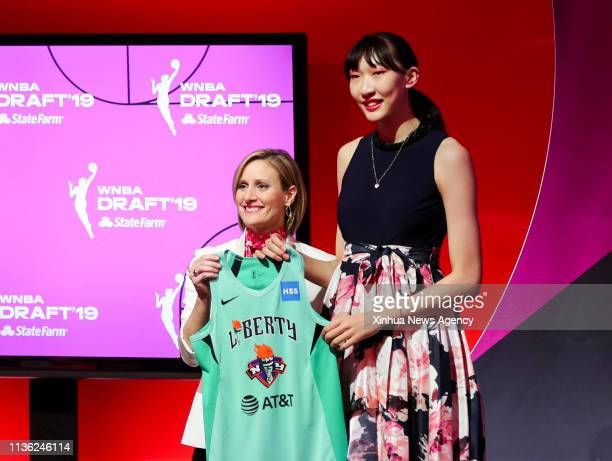 NEW YORK April 11 2019 Han Xu R of China poses for a photo with WNBA COO Christy Hedgpeth after being selected by the New York Liberty in the second...