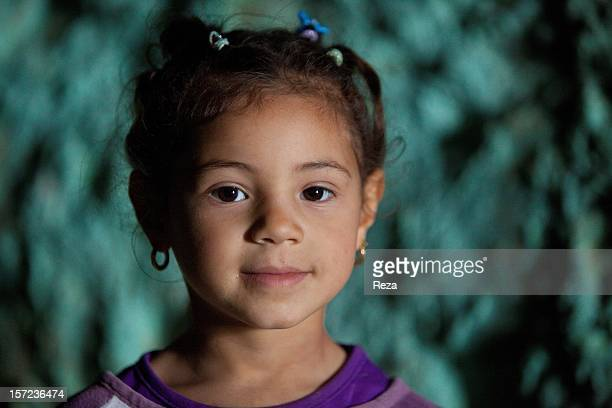 April 11th Algeria A small girl Fatime in the Aidour cave previously inhabited during the Neolithic period