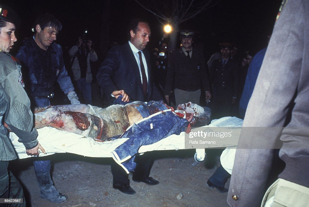 April 12, 1985. Madrid (Spain). Terrorist attack against the restaurant 'El Descanso' Firemen and members of the Red Cross carry a dead man in a stretcher. This terrorist attack against military men of the North American base of Torrejon was attributed to : News Photo