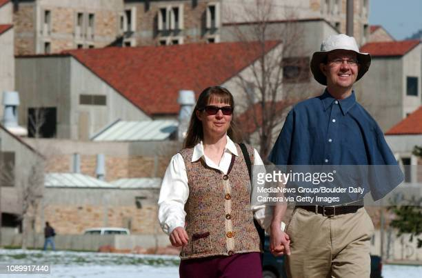 April 12, 2005 / Boulder Colo / Eric Cornell and his wife Celeste Landry walk toward the Coors Event Center to meet with the media to talk about...