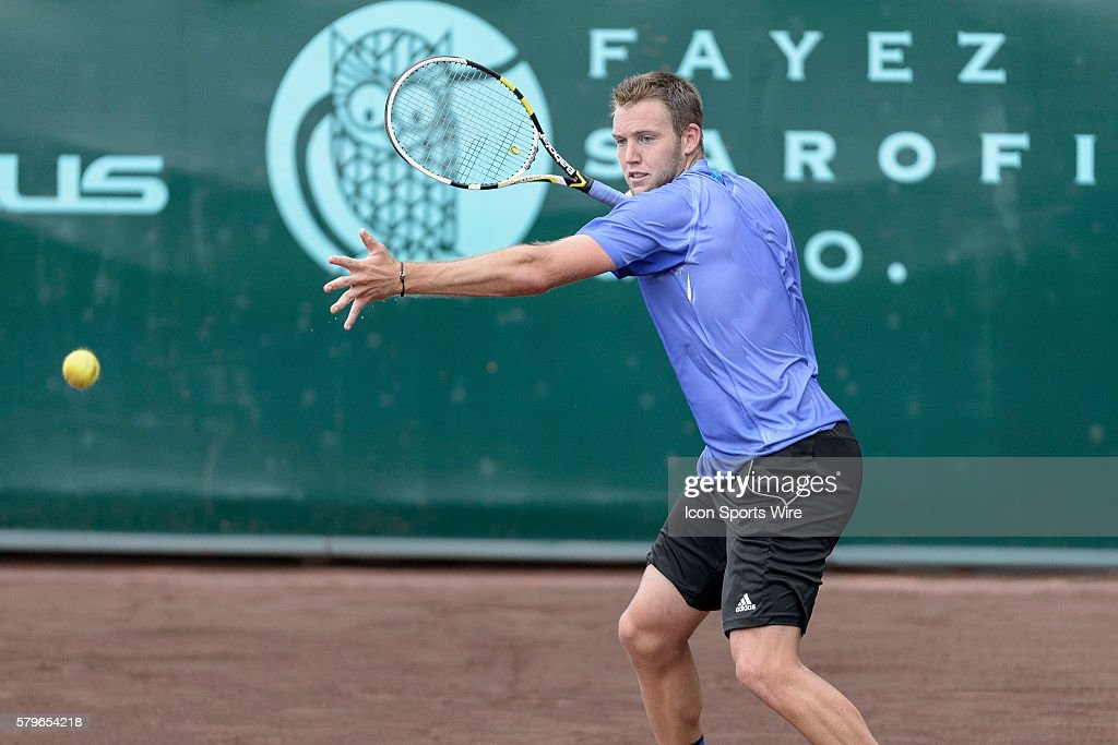 April 12, 2015 Jack Sock returns a serve from Sam Querrey in the finals of the U.S. Men's Clay Court Championship at River Oaks Country Club in Houston Texas.