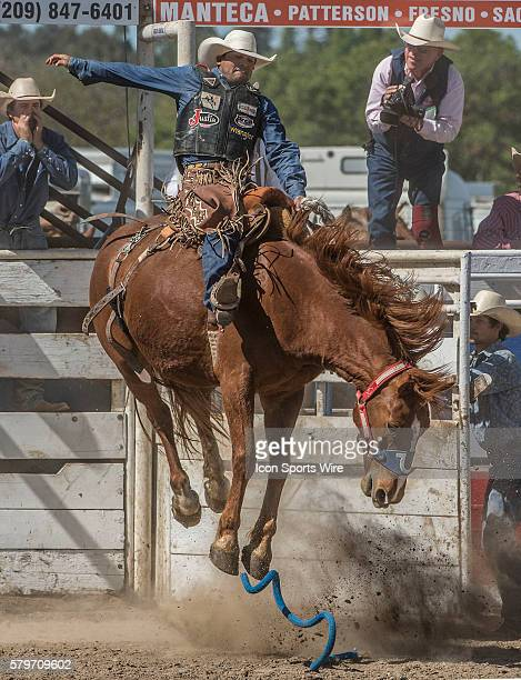 Saddle bronc rider Joaquin Real from Santa Paula California scores 78 points at the 64th Annual Oakdale Rodeo on Sunday April 12 2015