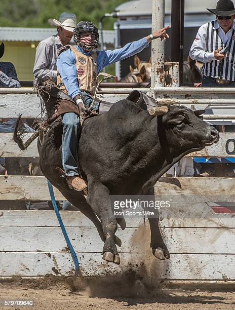 Sammy Matthews from Springville, California scores 77 points in bull riding at the 64th Annual Oakdale Rodeo on Sunday April 12, 2015.
