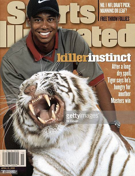 April 13 1998 Sports Illustrated Cover Golf Masters Preview Casual closeup portrait of Tiger Woods with stuffed snow tiger Sansom Cover Orlando FL...