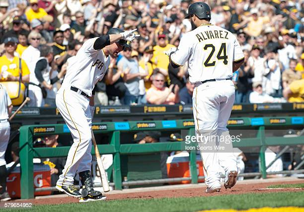 Pittsburgh Pirates first baseman Pedro Alvarez is greeted by shortstop Jordy Mercer after hitting a solo home run during the seventh inning in the...