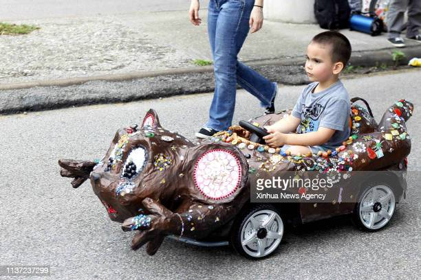 HOUSTON April 13 2019 A boy drives his mobile masterpiece in Houston Texas the United States on April 13 2019 The 32nd Annual Houston Art Car Parade...