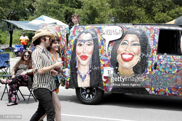 HOUSTON April 13 2019 People pass by the mobile masterpiece in Houston Texas the United States on April 13 2019 The 32nd Annual Houston Art Car...