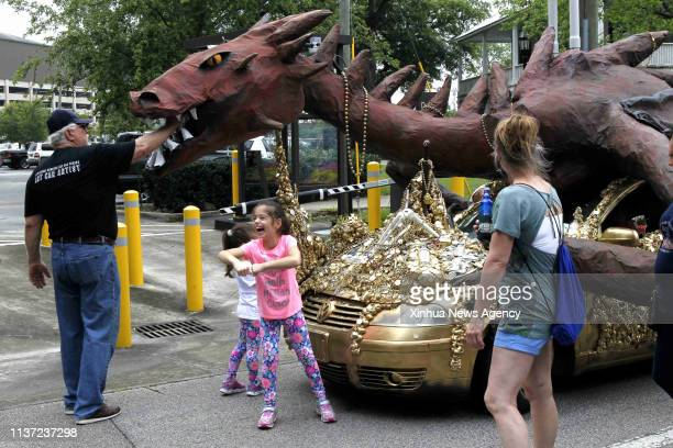 April 13, 2019 -- People watch the mobile masterpiece in Houston, Texas, the United States on April 13, 2019. The 32nd Annual Houston Art Car Parade...